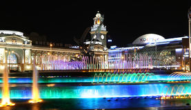 Square of  Europe, Animated fountain and Kiyevskaya railway station  lit at night, Moscow, Russia Stock Image