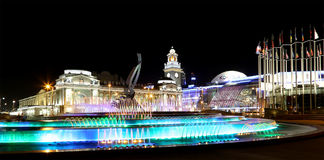 Square of  Europe, Animated fountain and Kiyevskaya railway station  lit at night, Moscow, Russia Royalty Free Stock Photo