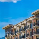 Square Exterior of a residential building under blue sky with clouds on a sunny day stock photos