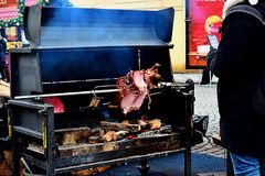 On the square during the festival, a piece of meat is roasted on a spit. Prague, Czech Republic stock images