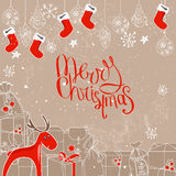 Square festive frame with gift boxes and Santa socks. Royalty Free Stock Images