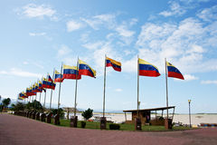 Square with flags. In La Vela de Coro, Falcon State, Venezuela. For this place landed Francisco de Miranda the Precursor of the American Emancipation against Royalty Free Stock Images