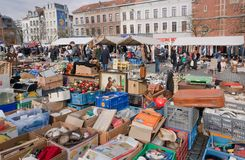 Square with flea market and many old art, bargains and antique stuff in mess of vintage decor and retro details. BRUSSELS, BELGIUM - APR 3: Square with flea Royalty Free Stock Photo