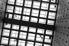 Square floor pattern, glass floor and walking people. Photographed in Black and White in the  Acropolis museum Royalty Free Stock Photos