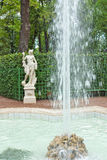 Square fountain and antique statue in the Summer Gardens park Stock Image