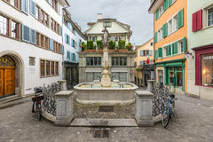 Square with a fountain in the center of Zurich city, Switzerland Royalty Free Stock Photos