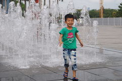 Square fountain landscape and children Royalty Free Stock Photography