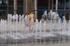 Square fountain landscape and children Royalty Free Stock Images