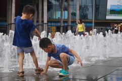 Square fountain landscape and children Royalty Free Stock Image