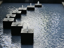 Square Fountain. A fountain near the Central Pier in Hong Kong made up of eight cubes laid out in a semi circle royalty free stock photos