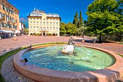 Square and fountain in Riva del Garda royalty free stock photography