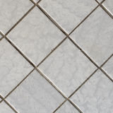 Square fragment of tiled wall Stock Photography