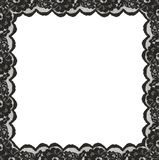 Square frame from black lace edges. On white background. Top view. Flat lay royalty free stock photo