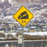 Square frame Close up of a yellow road grade sign with a truck on slope illustration stock photography