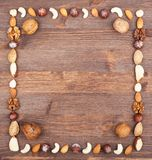 Culinary frame. Square frame from different varieties of nuts Royalty Free Stock Photos