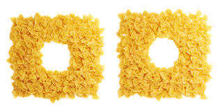 Square frame made of dry farfalle pasta over isolated white background Stock Photos