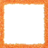 A square frame made of lentil seeds. On a white background Royalty Free Stock Image