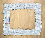 Square frame made of shredded newspaper pieces. Royalty Free Stock Images