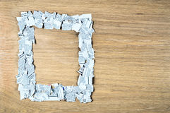 Square frame made of shredded newspaper pieces. Stock Images