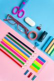 Square frame with stationery on pink and blue background. flat lay. Royalty Free Stock Image