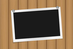 Square frame template on metal pins with shadows on brown wooden texture Stock Photography
