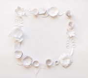 Square frame with white paper flowers. On white background. Cut from paper. Place for your text Royalty Free Stock Photography