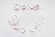 Square frame with white paper flowers. Flat lay. Nature concept. Cut from paper. Place for your text Stock Images