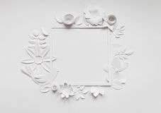 Square frame with white paper flowers. Flat lay. Nature concept. Cut from paper. Place for your text Stock Photo