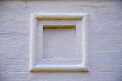 Square frame white stone wall. Square frame on a white stone wall Stock Photo