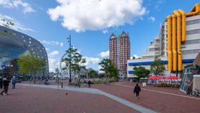 Large square with groups of people in front of the famous market hall in Rotterdam, the Netherlands. Square in front of the famous market hall and with the royalty free stock image