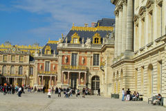 Square in front of Versailles palace full of tourists Stock Images