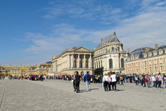 Square in front of Versailles palace full of tourists Stock Photos