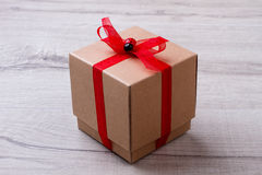 Square gift box with ribbon. Royalty Free Stock Photography