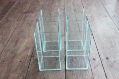 Square glass bowl for fish bowls placed. Royalty Free Stock Photography