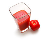 Square glass with juice and suare tomato. On white background Royalty Free Stock Images