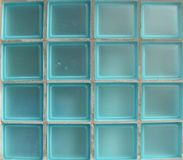 Square glass tiles from window in bright blue Royalty Free Stock Photo