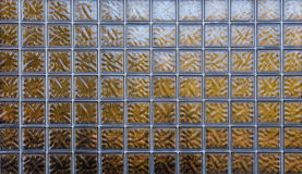Square Glass Window. Wonderful warm color in this stain glass window Royalty Free Stock Photography