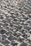 Square granite stones. On the pavement Stock Photos