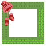 Square green crocheted frame, decorated with a red cap. And mittens. For decor, photo album.Vector EPS10 Stock Photo
