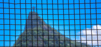 Square grid and blurry Corcovado mountain on the background Royalty Free Stock Photography