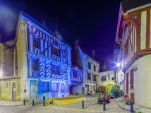 Square with half-timbered houses, in the medieval village Noyers. Night view of a square place de la petite etape aux vins, with half-timbered houses, in the Royalty Free Stock Images