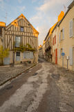 Square with half-timbered houses, in the medieval village Noyers. Sunset view of a square place de la madeleine, with half-timbered houses, in the medieval Royalty Free Stock Image