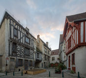 Square with half-timbered houses, in the medieval village Noyers. Sunset view of a square place de la petite etape aux vins, with half-timbered houses, in the Royalty Free Stock Photography