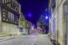 Square with half-timbered houses, in the medieval village Noyers. NOYERS-SUR-SEREIN, FRANCE - OCTOBER 11, 2016: Night view of a square place du grenier a sel Royalty Free Stock Images