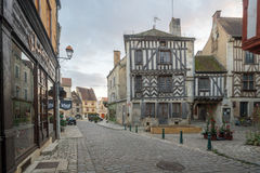 Square with half-timbered houses, in the medieval village Noyers. NOYERS-SUR-SEREIN, FRANCE - OCTOBER 11, 2016: Sunset view of the main square place de hotel de Royalty Free Stock Photography