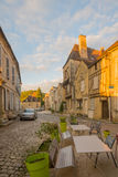 Square with half-timbered houses, in the medieval village Noyers. NOYERS-SUR-SEREIN, FRANCE - OCTOBER 11, 2016: Sunset view of a square place du grenier a sel Royalty Free Stock Photos