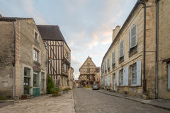 Square with half-timbered houses, in the medieval village Noyers. NOYERS-SUR-SEREIN, FRANCE - OCTOBER 11, 2016: Sunset view of a square place du grenier a sel Stock Image