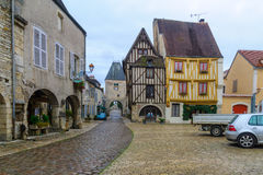 Square with half-timbered houses, in the medieval village Noyers. NOYERS-SUR-SEREIN, FRANCE - OCTOBER 13, 2016: View of the main square (place de hotel de Royalty Free Stock Photos