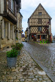 Square with half-timbered houses, in the medieval village Noyers. NOYERS-SUR-SEREIN, FRANCE - OCTOBER 13, 2016: View of a square place du grenier a sel, with Stock Photography
