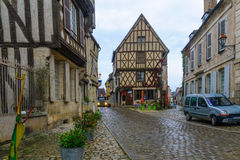 Square with half-timbered houses, in the medieval village Noyers. NOYERS-SUR-SEREIN, FRANCE - OCTOBER 13, 2016: View of a square (place du grenier a sel&# Stock Photography